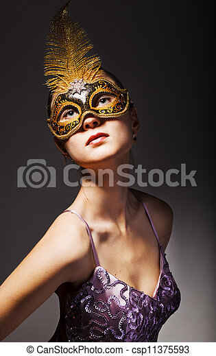 Portrait of beautiful young woman wearing black carnival mask - csp11375593
