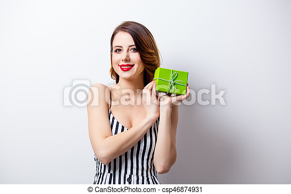 portrait of beautiful young woman with gift on the wonderful white studio background - csp46874931