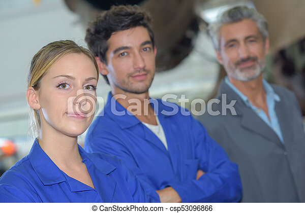 Portrait of blue collar workers stood in a row - csp53096866