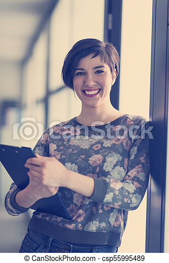 portrait of business woman in casual clothes at startup office - csp55995489