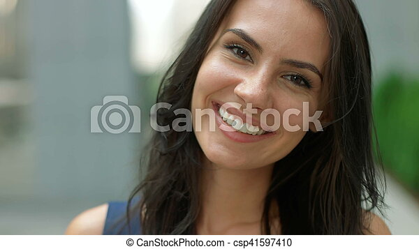 Portrait of business woman smiling outdoor - csp41597410