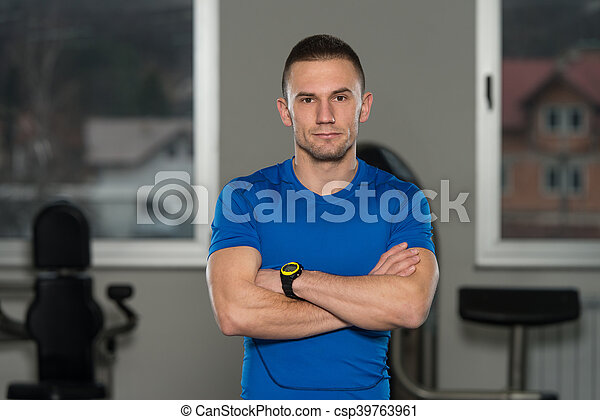 Portrait Of Caucasian Instructor In Fitness Center Gym - csp39763961