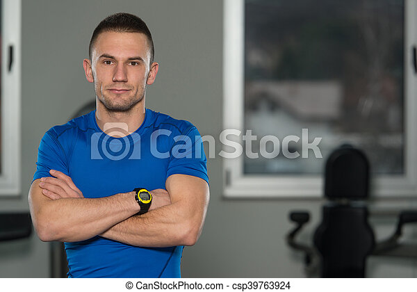 Portrait Of Caucasian Instructor In Fitness Center Gym - csp39763924