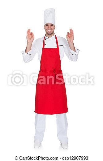 Portrait of cheerful chef in uniform - csp12907993