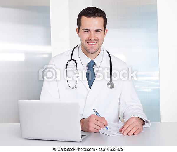 Portrait of cheerful doctor - csp10633379