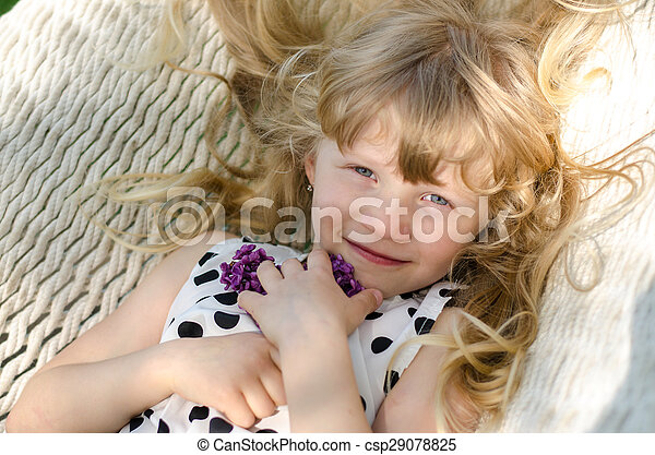 portrait of child lying in hammock - csp29078825
