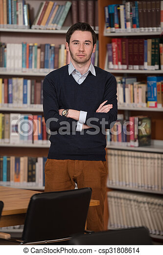 Portrait Of Clever Student In Library - csp31808614