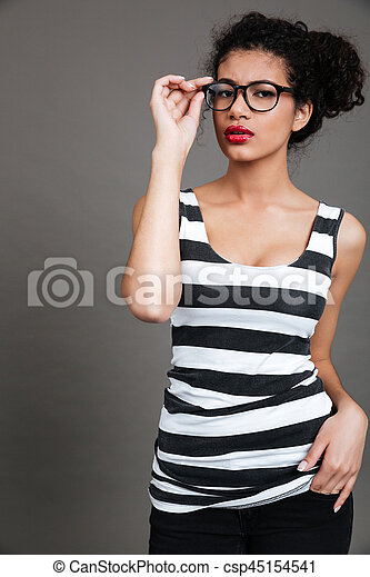 Portrait of confident african american young woman in glasses - csp45154541