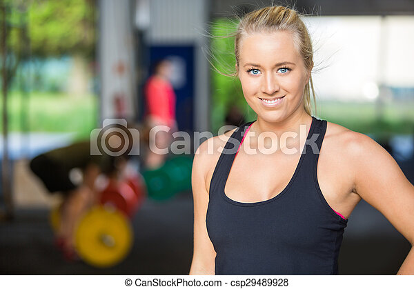 Portrait Of Confident Fit Woman at Cross-Fitness Gym - csp29489928