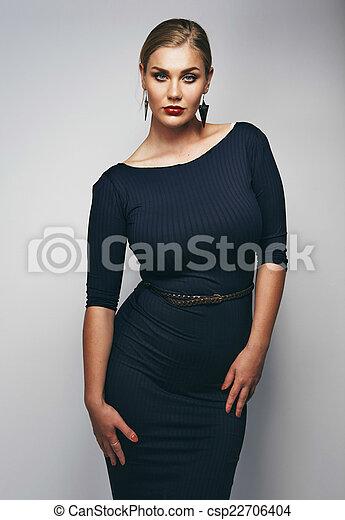 0e79ac5f9b7 Portrait of confident plus size model posing. Portrait of attractive ...