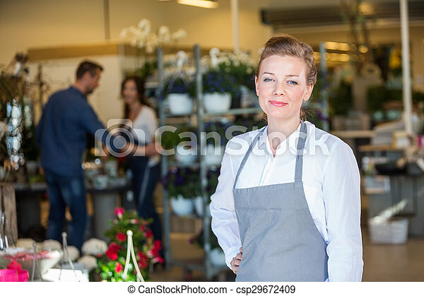 Portrait Of Confident Salesperson In Flower Shop - csp29672409
