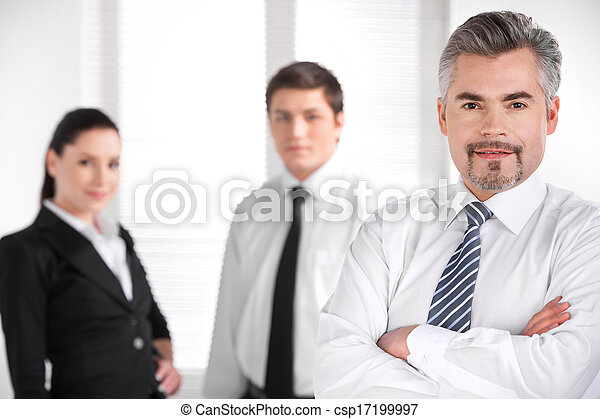 portrait of confident successful business man blur business people