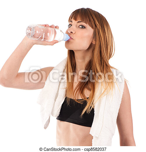Portrait of confident young woman in sportswear holding a water  - csp8582037