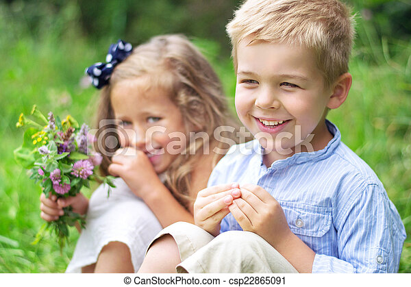 Portrait of cute children with flowers - csp22865091