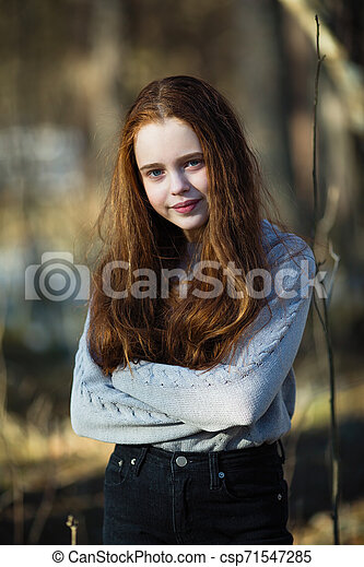 Portrait of cute girl with fiery red hair in the park. - csp71547285