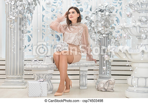Portrait of cute young woman with present box - csp74503498