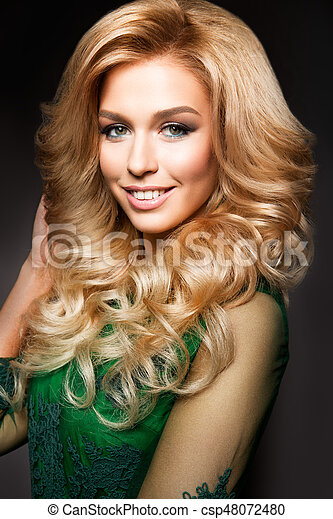 Portrait Of Elegant Sexy Blonde Woman With Long Curly Hair And Glamour Makeup