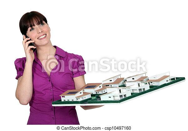 portrait of female architect holding model - csp10497160