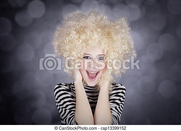 Portrait of funny woman in blonde wig. Studio shot. - csp13399152