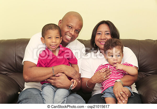 Portrait of gorgeous african family. Focus on the mother and the - csp21015617