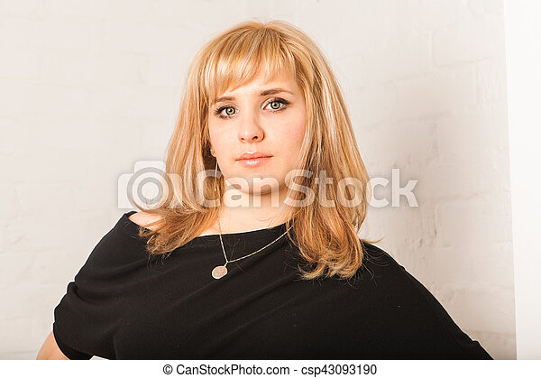 Portrait of gorgeous blonde woman in the room. Beauty, fashion. - csp43093190