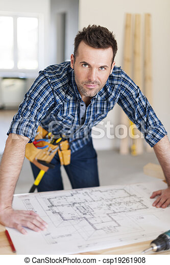 Portrait of handsome construction worker with home plans  - csp19261908