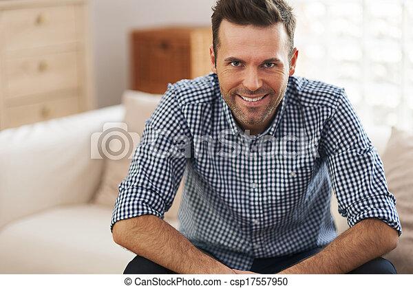 Portrait of handsome man in living room  - csp17557950