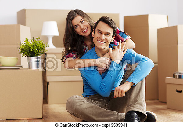 Portrait of happy couple in new home - csp13533341