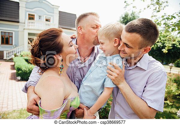 Portrait of Happy Family In Park - outdoor shot - csp38669577