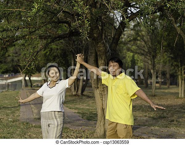 Portrait of Happy Family In Park  - csp13063559