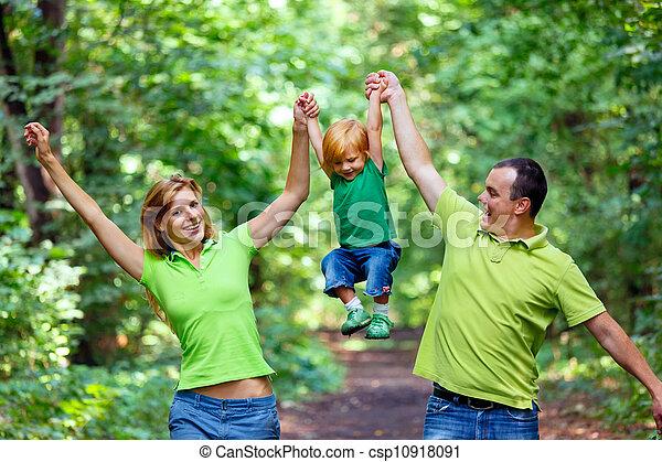 Portrait of Happy Family In Park - csp10918091
