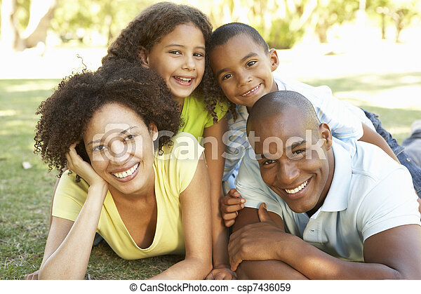 Portrait of Happy Family Piled Up In Park - csp7436059