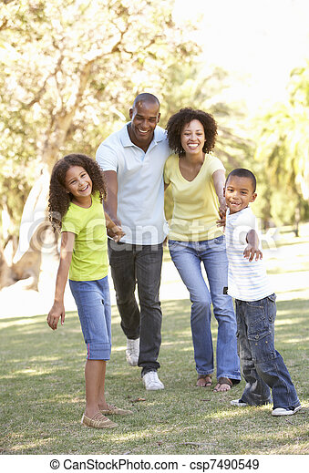 Portrait of Happy Family Walking In Park - csp7490549