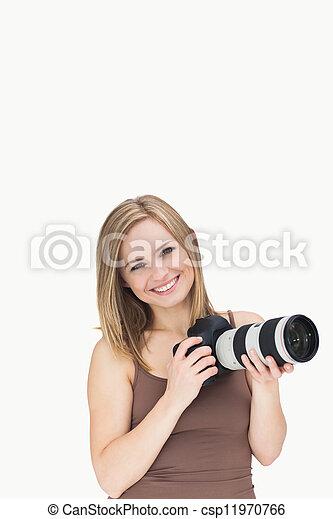 Portrait of happy female with photographic camera - csp11970766