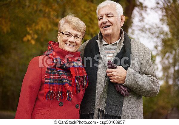 Portrait of happy grandparents in the park - csp50163957