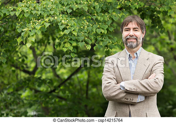 Portrait of happy middle-aged businessman looking at camera and smiling, outdoors - csp14215764