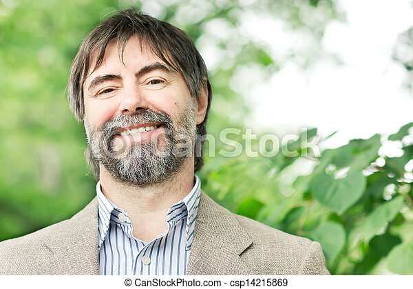 Portrait of happy middle-aged businessman looking at camera and smiling, outdoors - csp14215869