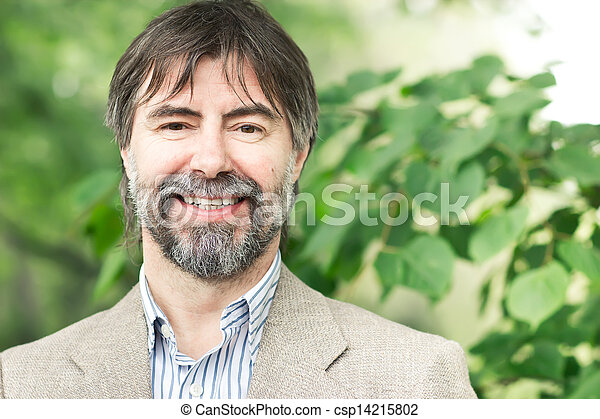 Portrait of happy middle-aged businessman looking at camera and smiling, outdoors - csp14215802