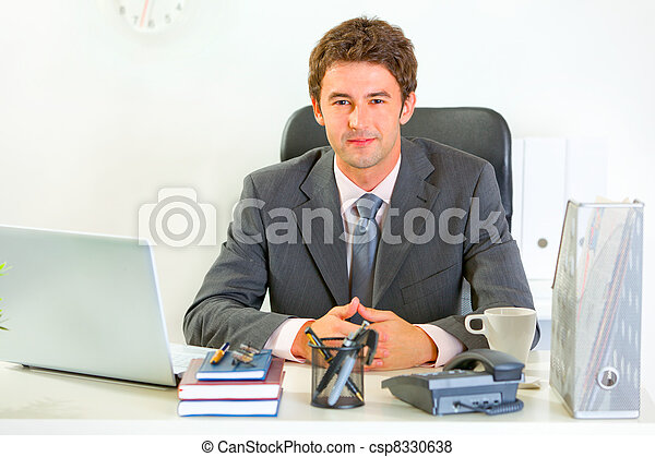 Portrait of happy modern businessman in office - csp8330638