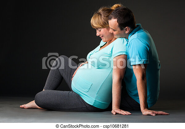 Portrait of happy young family together waiting for baby - csp10681281