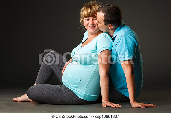 Portrait of happy young family together waiting for baby - csp10681307