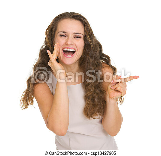 Portrait of happy young woman pointing on copy space - csp13427905