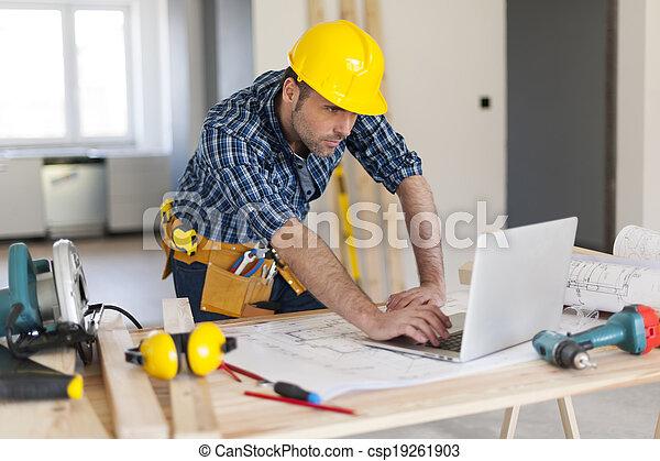 Portrait of hard working building contractor - csp19261903
