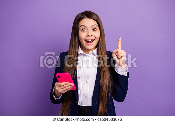Portrait of her she nice brainy small little cheerful cheery long-haired creative girl using gadget got great idea solution isolated bright vivid shine vibrant lilac violet color background - csp84583675