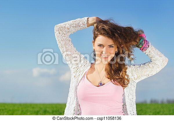 Portrait of joyful charming young woman - csp11058136