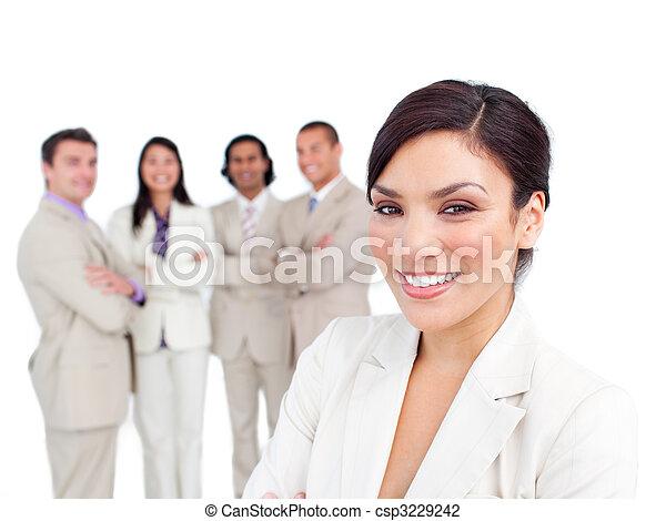 Portrait of latin businesswoman smiling with his team - csp3229242