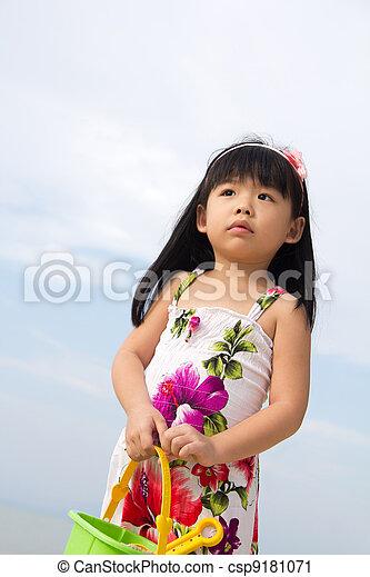 Portrait of little girl on beach - csp9181071