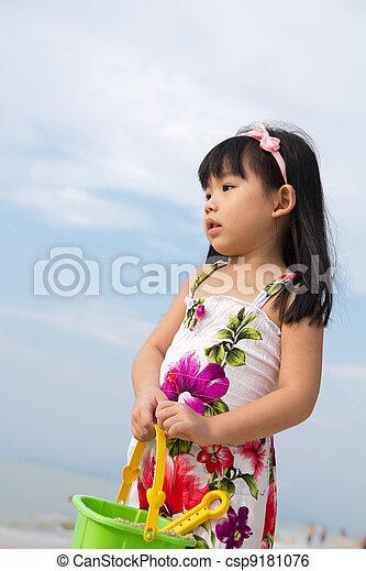 Portrait of little girl on beach - csp9181076