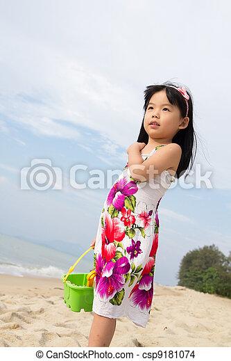 Portrait of little girl on beach - csp9181074
