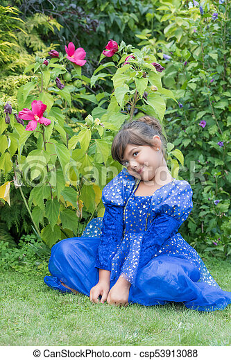 Portrait Of Little Girl Sitting In Front Of A Hibiscus Portrait Of